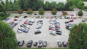 Time lapse shot of busy parking lot Royalty Free Stock Photo
