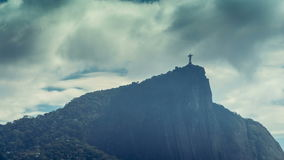 Time lapse shot of Corcovado Hill with clouds dynamic passing the Christ in Rio de Janeiro stock footage