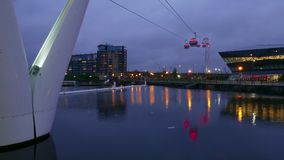Time-Lapse-shot of Emirates Airline aerial passenger tramway London by night stock footage