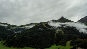 Alpine rain weather time lapse. Time lapse shot of fog and rain clouds gathering around alpine mountains of the Austrian Hohe Tauern region before a heavy stock video