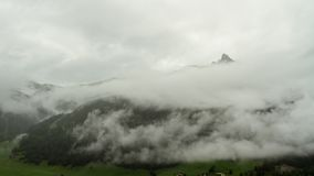 Alpine rain weather time lapse. Time lapse shot of fog and rain clouds gathering around alpine mountains of the Austrian Hohe Tauern region before a heavy stock video footage