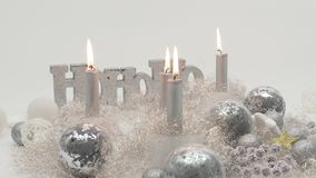 Time lapse shot of four silver candles burning down in festive decoration stock footage