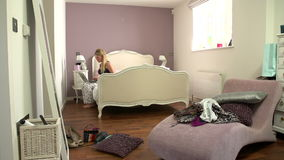 Time Lapse Shot Of Girl Getting Up And Ready In Bedroom stock video footage