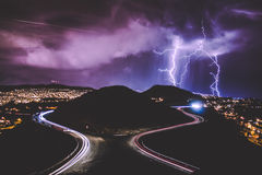 Time Lapse Shot of Lightning from Cloudy Dim Sky over Silhouette of Mountains Near Cities during Night Stock Photo