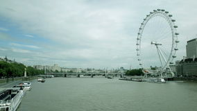 Time lapse shot of London's river Thames with tour boats and the London Eye stock video