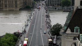Time lapse shot of London's Westminster Bridge with busy traffic. Westminster Bridge seen from a high vantage point with busy traffic and pedestrians with stock footage