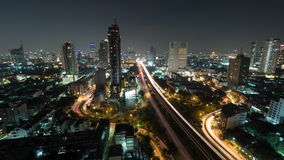 Time lapse shot of night life in the big city, lighted skyscraper, traffic, intersection, Bangkok, Thailand stock video footage
