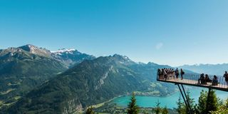 Tourists at viewpoint in Harder Kulm. A time lapse shot of tourists at a viewpoint in Harder Kulm, Switzerland stock footage