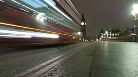 Time-Lapse-shot of Westminster Bridge and Big Ben by night. Time lapse shot of Westminster Bridge and Big Ben by night stock footage