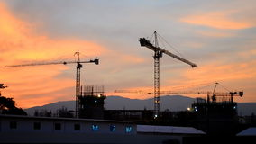 Time lapse silhouette crane building and dusk time Royalty Free Stock Photos
