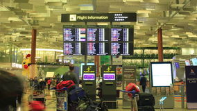 Time-lapse: Singapore, Changi International Airport, Visitors Looking at Departures Board
