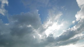 Time-lapse sky with highlighted clouds. Brightness from the sky. stock video footage