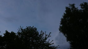 Time-lapse of sky turning from evening to dusk. A time-lapse shot of the night sky as it transitions from evening to twilight stock footage