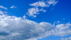 Time lapse,Slow motion fluffy clouds moving on blue sky background,