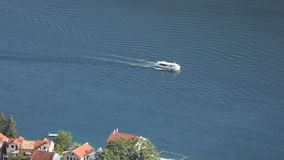 Time lapse - small boat passing by the coast. On clear summer day - high angle view stock video
