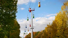 Time-lapse of a small cable car. Multicolored cabs float against the blue sky. stock footage