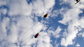 Time-lapse of a small cable car. Multicolored cabs float against the blue sky. stock video footage