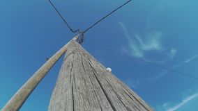 Electric Snail Shell. Time Lapse Of A Snail Shell On A Wooden Electricity Pole Against Blue Summer Skies stock video footage