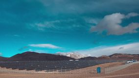 Time lapse, Solar Panels open, close as clouds glide by. clouds move in the tops of snow-capped mountains stock video footage