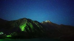 Time Lapse of stars and perseids shower in Big Almaty lake stock footage
