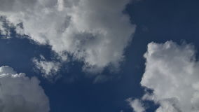 Time lapse stock footage of clouds passing over blue sky, India. Beautiful time lapse stock footage of white and fluffy clouds passing over blue sky. Indian sky stock video footage