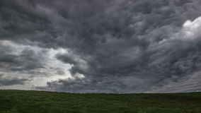 Time lapse storm clouds moving over the field. Spring landscape footage stock footage