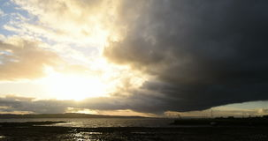 Time-lapse of storm clouds rolling in over coastal stock video