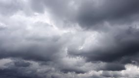 Time Lapse Stormy Cinematic Clouds. Video shows time lapse Stormy Cinematic Clouds in dark mysterious sky. The sky looks completely mystical, offering a nice stock video