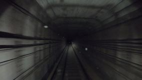 Time lapse of subway train starts from a dead end and moving at dark tunnel. Fast speed underground train riding in a