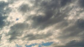Time lapse summer dramatic clouds fly across a bright blue sky. stock video footage