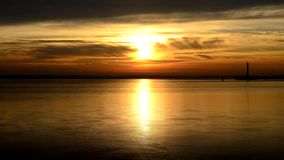 Time lapse of sun rise at dawn on the sea, ocean or river stock video