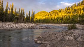 Time-lapse of sun rising along the Elbow River. In Kananaskis Country, Alberta Canada stock footage