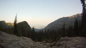 Time lapse of the sun rising in Glacier National Park. Sun kissed mountain ridge. stock video