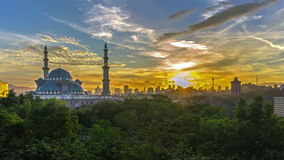 Time lapse. Sunrise at Federal Mosque, Kuala Lumpur with silhouette Kuala Lumpur city skyline. stock footage