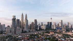 Time-lapse of sunrise in Kuala Lumpur skyline around Petronas twin towers stock footage