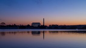 Time lapse of sunrise on Lincoln Memorial and Washington Monument in Washington, DC stock video footage