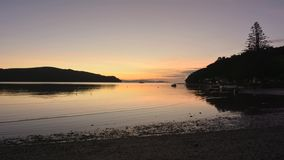 Time lapse of sunrise over Sandspit beach New Zealand stock video