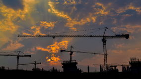 time lapse sunrise and silhouette crane working in stock footage