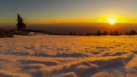 Time lapse sunrise in winter snowy mountains stock footage