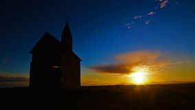 Time Lapse Sunset with church on hill stock footage