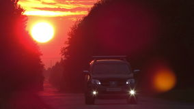 Time lapse sunset country road with car ligths stock footage
