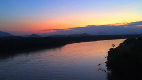 Time-lapse sunset on the fast flowing river