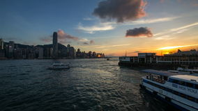 Time lapse of sunset at Ferry Pier in Kowloon Hong Kong. VICTORIA HARBOUR, HONG KONG - MAY 31, 2014: Time lapse of sunset at Ferry Pier in Tsim Sha Tsui in stock video
