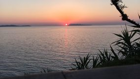 Time lapse sunset in Greece. Time lapse footage of sunset over the Ionian Sea as seen from Peroulades, in the north of the island of Corfu, Greece stock video