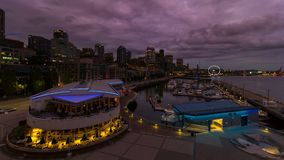 Time lapse of sunset over downtown waterfront in Seattle WA into blue hour 4k stock video