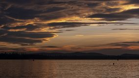 Time lapse at the sunset over the lake stock footage
