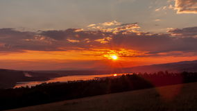 Time Lapse of Sunset over a Mountain and forest Lake. 4K TimeLapse. stock video footage