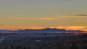 Time lapse sunset over mountain range stock video footage
