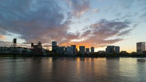 Time lapse of sunset over Portland OR skyline along Willamette River at dusk 4k. UHD 4k time lapse movie of colorful sunset over Portland Oregon downtown city stock video