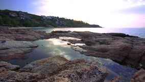 Time lapse of Sunset over a rocky coast on Koh stock video footage